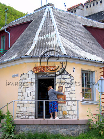 """<font size=""""+2"""">   <b> Kazimierz Dolny</b></font>  The town of Kazimierz Dolny is located 50 Km East of Lublin, on the bank of the Vistula River. It is a small, picturesque town of 2,300 inhabitants in the midst of natural forests and attracts many artists and writers. In the 14th century the town belonged to King Kazimierz Wielki The Great who constructed a castle on a nearby hill. The town prospered due to investments by Kaimierz The Great and taxes collected from travelers on the Vistula. Today most townspeople earn a living from tourism, small hotels and hostels.   <b>Click on photo to enlarge</b>"""