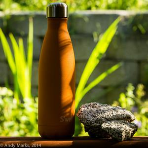 S'well bottle, split granite, on the railing 10' away.