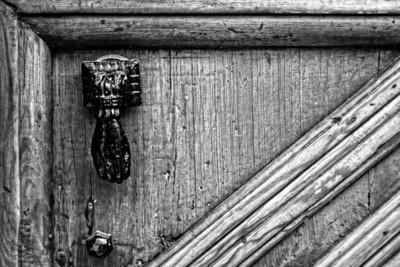 Metal knocker on old wooden door