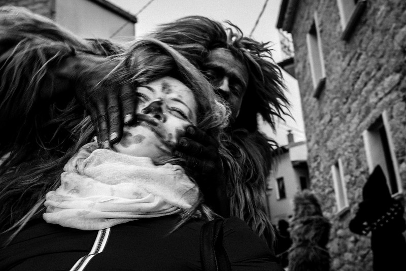 February 2017- Lodine, Sardinia – Italy. S'Urthu (the bear) of Fonni wears sheepskin, and has a soot-smeared face, at his neck he wears a large cowbell and is tied to a heavy iron chain.