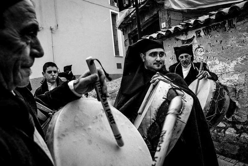 "February 2017- Lodine, Sardinia – Italy. ""Sos Tamburinos"" in Gavoi. Adults and children parade wearing the typical velvet costume.  The parade unwinds throughout the streets of the center of the village, with the drums playing wildly."