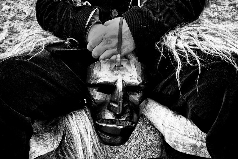 January 2014 - Mamoiada, Sardinia – Italy. Mamuthones wear grotesque wooden masks, painted black. They are all handmade by local artisans, all different. Some have giant hooked noses, others have protruding foreheads, pointed chins and grimacing expressions, lending mamuthones a spooky, devilish appearance.