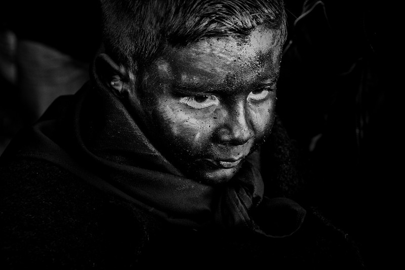 February 2018- Lula, Sardinia – Italy. A child with a black ash face is preparing for the ritual.