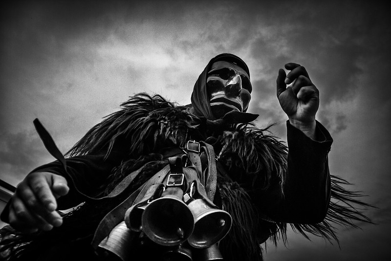 January 2015 - Mamoiada, Sardinia – Italy. One of the symbols of Sardinia is a traditional black mask with grotesque features related to Carnival: the name of this traditional costume is Mamuthones. In the rest of Italy carnival parties and parades feature funny masks, bright colors and allegorical floats; in Mamoiada, a town in province of Nuoro, the tradition is completely different, because Mamuthones masquerade is similar to a mystical experience.