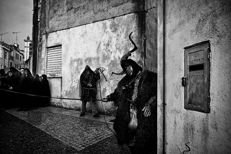 March 2014 - Lula, Sardinia – Italy. Su Battileddu, the mask of the Carnival of Lula, is surely one of the most impressive carnival masks Sardinian. His face is covered with blood and blackened by soot and the body covered with sheepskins and sheepskin. On the head bears two horns between which is secured a stomach goat, while on the belly, under the cowbells, a stomach filled with ox blood, which is washing occasionally. Su Battileddu is the sacrifice of the carnival. Around him move from black face masks that attack him repeatedly to kill him.