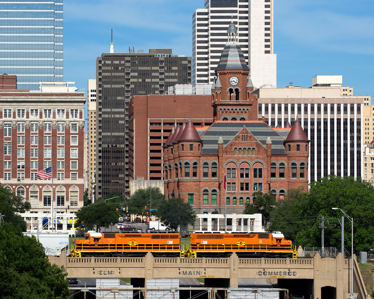 Dallas, Garland & Northeastern (DGNO), a Genesee & Wyoming Inc. Railroad,  in front of Dallas County Old Red Courthouse, Dealey Plaza, Dallas, TX (May 2017)