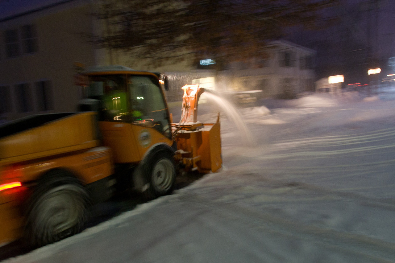 Sonny from the Norwich Public Works Department clears the sidewalks of downtown Norwich, Vermont after a massive February snow storm