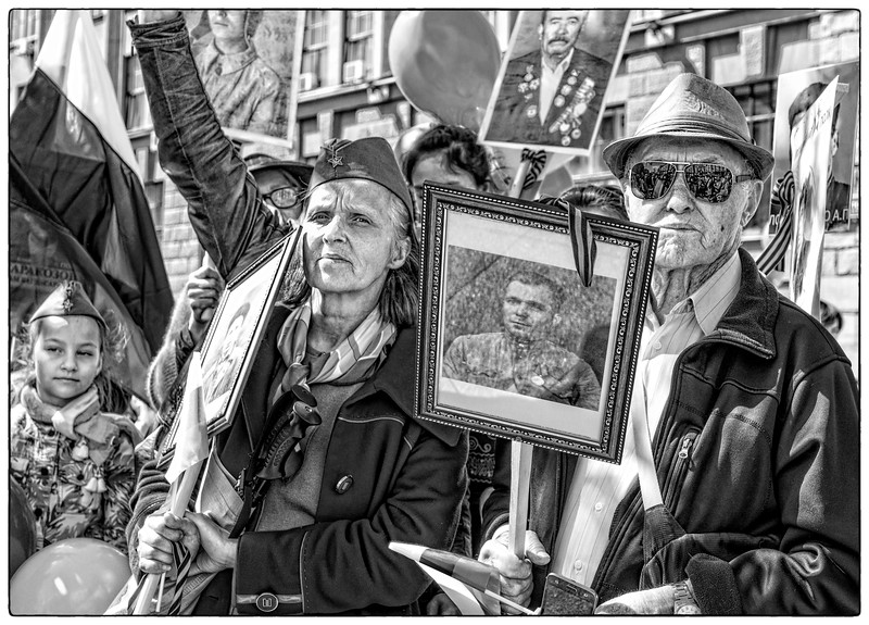 Marchers carry portraits of lost loved ones