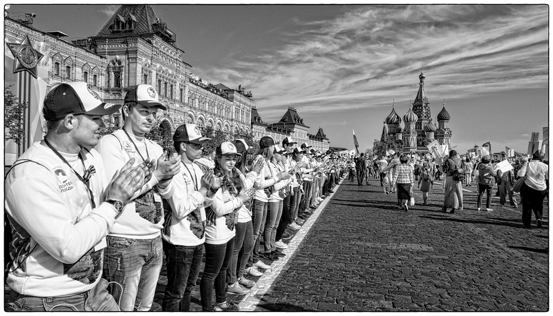 Kremlin Square is lined with volunteers directing the crowds .