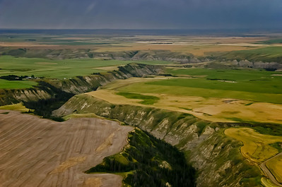 """Pure prairie dropping suddenly into the gash of the badlands""."