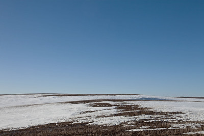 Snow patterns on spring landscape.