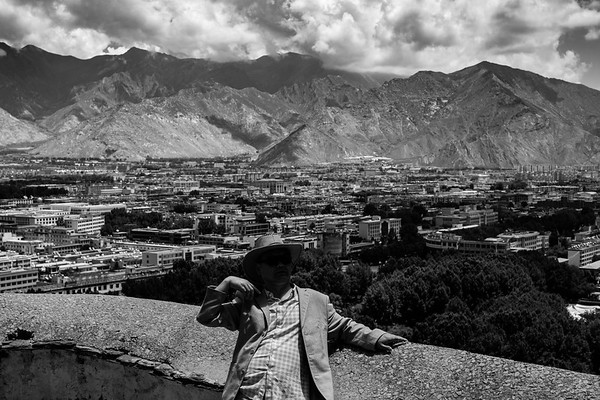 A male tourist poses for photo at the Potala Palace in Lhasa, TAR on July 24, 2018.