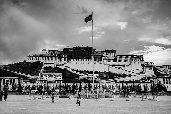 A large Chinese flagpole is situated across the street from the Potala Palace in Lhasa, TAR on July 24, 2018.