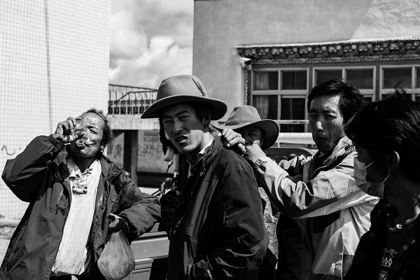 A group of Tibetan males gather around in rural village of TAR on July 27, 2018.