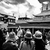 A group of tourists take photographs on the second story of the Jokhang Temple in Barkhour Square in Lhasa, TAR on July 24, 2018.