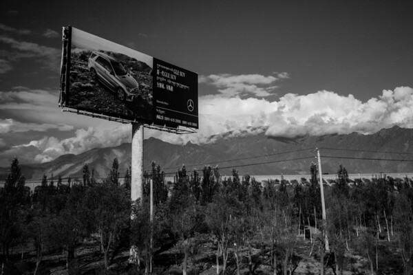 A Mercedes billboard stands tall along a highway in rural Tibet on July 25, 2018.