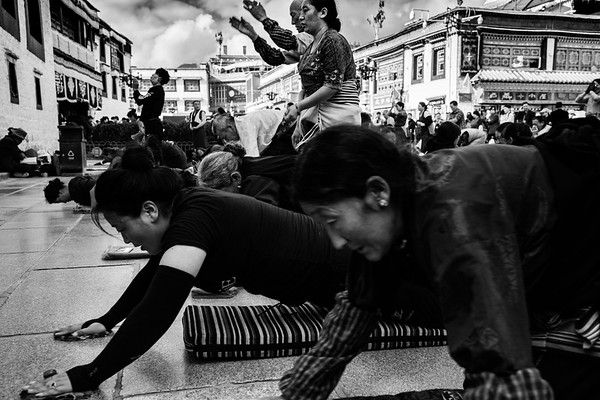 Several Tibetans prostrate in front of the Jokhang Temple in Barkhour Square in Lhasa, TAR on July 24, 2018.