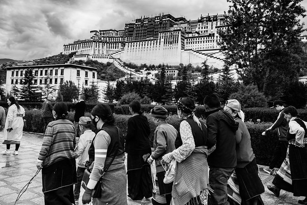 Tibetans circumambulating around the Potala Palace, former residence to His Holiness the Dalai Lama, in Lhasa, TAR on July 22, 2018.