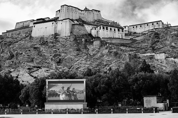 A large television screens Chinese propaganda below the Gyantse Fortress in the small town of Gyantse, TAR on July 25, 2018.