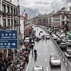 Traffic jam on the Beijing road, the most important artery in Lhasa, leading to the Potala (in the background). Chinese flags are installed on the buildings. Lhasa, Tibet Autonomous Region, China, July 22 2018.<br /> ----<br /> Bouchon de circulation sur la route de Beijing, plus importante artere de Lhassa se rendant jusqu'au Potala (en arrière-plan). Des drapeaux chinois sont installes sur les batiments. Lhassa, Region autonome du Tibet, Chine, Juillet 22 2018.