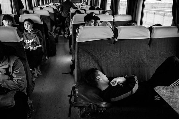 Passengers are settled into the soft seater car of the Qinghai-Tibet Railway train in July 2018.