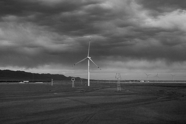 Windmills along the Qinghai-Tibet Railway collect energy in July 2018.
