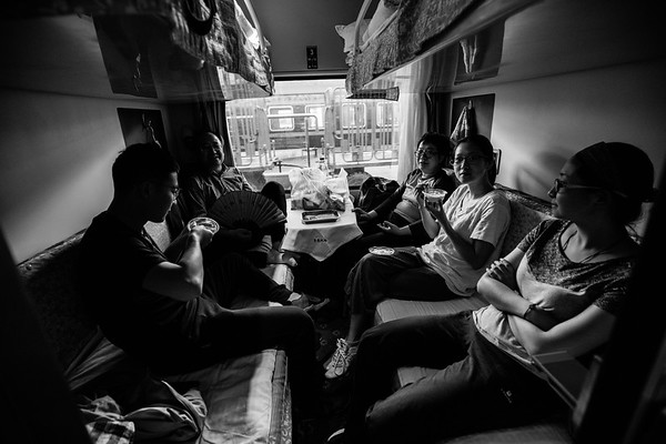 A Chinese family enjoys train-bought Yak yogurt in the comfort of their first class cabin on the Qinghai-Tibet Railway train in July 2018.