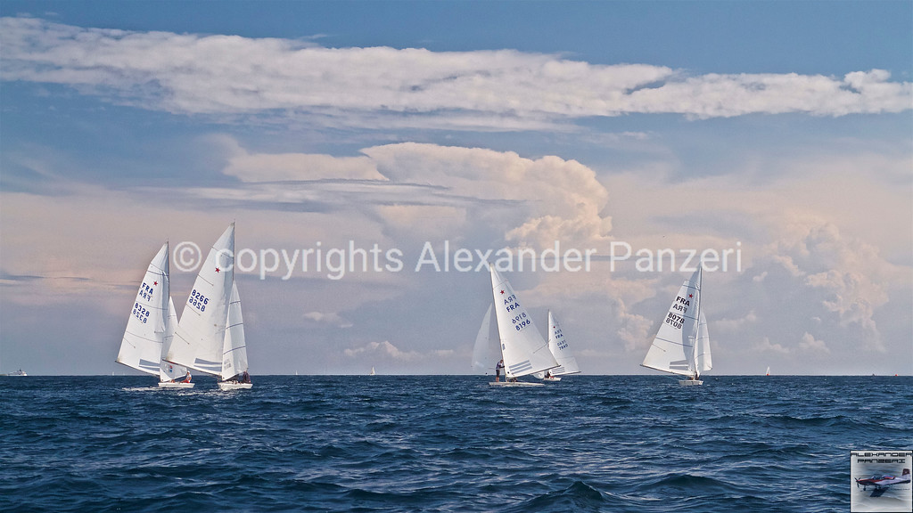 Downwind leg and the storm cell in background - copyright © photo Alexander Panzeri