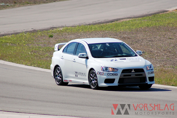 Brian driving the EVO X at Harris Hill Road's 1.8 mile road course in San Marcus, TX. We had the track to ourselves for the day on March 3, 2009, and got in a lot of testing, dialing in the road course setup.