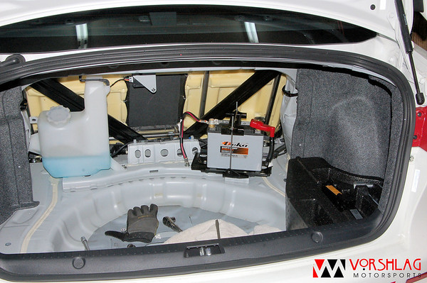 Deka AGM lightweight battery mounted in the trunk of the EVO (using the factory mount and a spacer)