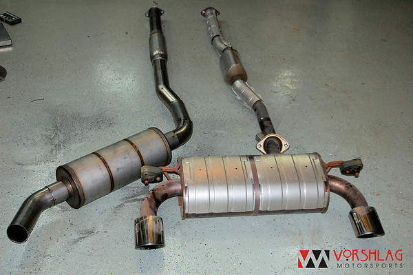 New exhaust (left) next to factory exhaust (right).