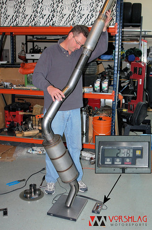 Fair balances the new exhaust on the scale and it comes in at 23.8 pounds, for a weight savings of about half.