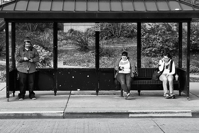 Waiting together alone for the bus.
