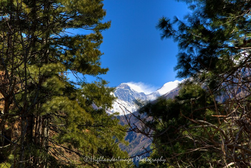 Our first view of Mount Everest through the trees half way up the climb towards Namche Bazaar from Jorsalle.