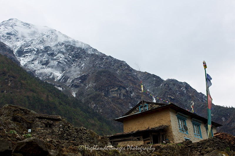 House at Monjo with the large snowy mountains behind.