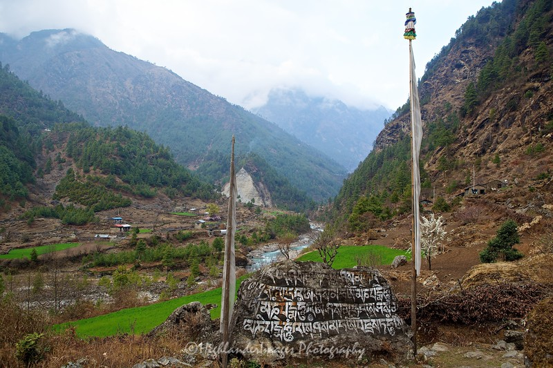 Mani stones close to the Dudh Kosi river on the trail from Lukla to Phakding