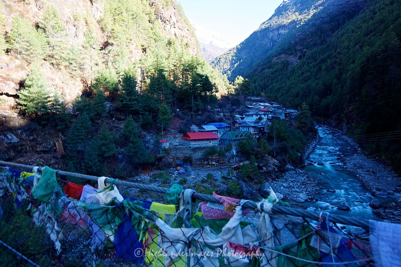 Another river crossing on a suspension bridge festooned with prayer flags at Jorsalle by the Dudh Kosi River in the Khumbu Valley between Monjo and Namche Bazaar.