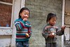 Two small children accept our chocolate at a small village between Phakding and Monjo.