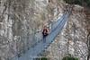 Kenny crossing a suspension bridge between Lukla and Phakding