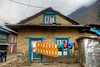 Drying clothes outside a house on the main street in Lukla.