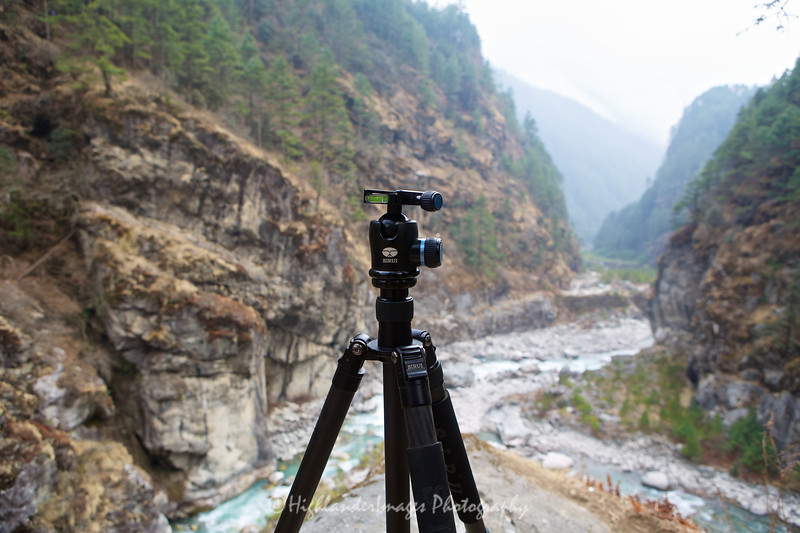 Sirui N-2204 tripod in action next to the suspension bridge over the river at the bottom of the steep track from Namche Bazaar on the route towards Phakding.