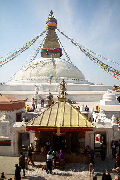 Boudhanath (also called Boudha, Bouddhanath or Baudhanath or the Khāsa Caitya) is one of the holiest Buddhist sites in Kathmandu (Yambu), Nepal. It is known as Khāsti in Nepal Bhasa Jyarung Khasyor in Tamang language or as Bauddha by modern speakers of Nepali. Located about 11 km (6.8 miles) from the center and northeastern outskirts of Kathmandu, the stupa's massive mandala makes it one of the largest spherical stupas in Nepal. The Buddhist stupa of Boudhanath dominates the skyline. The ancient Stupa is one of the largest in the world.  Boudhanath (also called Boudha, Bouddhanath or Baudhanath or the Khāsa Caitya) is one of the holiest Buddhist sites in Kathmandu (Yambu), Nepal. It is known as Khāsti in Nepal Bhasa Jyarung Khasyor in Tamang language or as Bauddha by modern speakers of Nepali. Located about 11 km (6.8 miles) from the center and northeastern outskirts of Kathmandu, the stupa's massive mandala makes it one of the largest spherical stupas in Nepal. The Buddhist stupa of Boudhanath dominates the skyline. The ancient Stupa is one of the largest in the world.