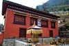 Prayer wheel and small monastery between Koshigaun village and Phakding