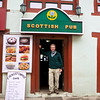 Stuart in the entranceway of the Scottish Bar in Lukla. Note the Everest burger and yak steaks on the billboard menu.