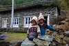 Two children in their matching hats between Koshigaun village and Phakding