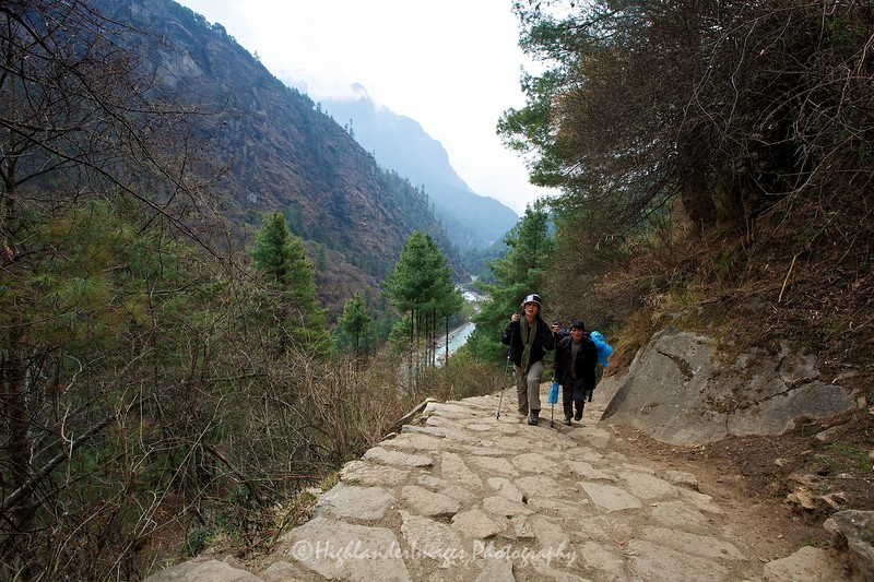 Between Phakding and Monjo. Suit Yoo heads up the steep stepped trail closely followed by her porter Gunga Rai … obviously a distant descendant of the great Gunga Din!