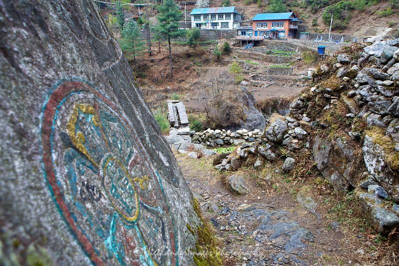 Mani stones at Koshigaun village between Lukla and Phakding
