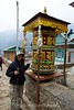 Suit Yoo spins the prayer wheel for good fortune at the start of the trek between Lukla and Phakding