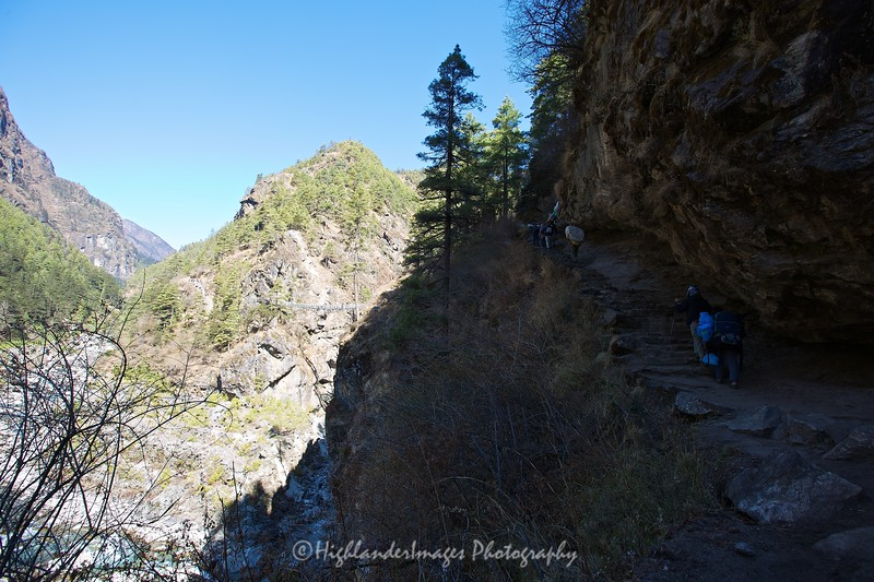 The approach to the high suspension bridge between Jorsalle and Namche Bazaar required a steep climb up along the cliff face.