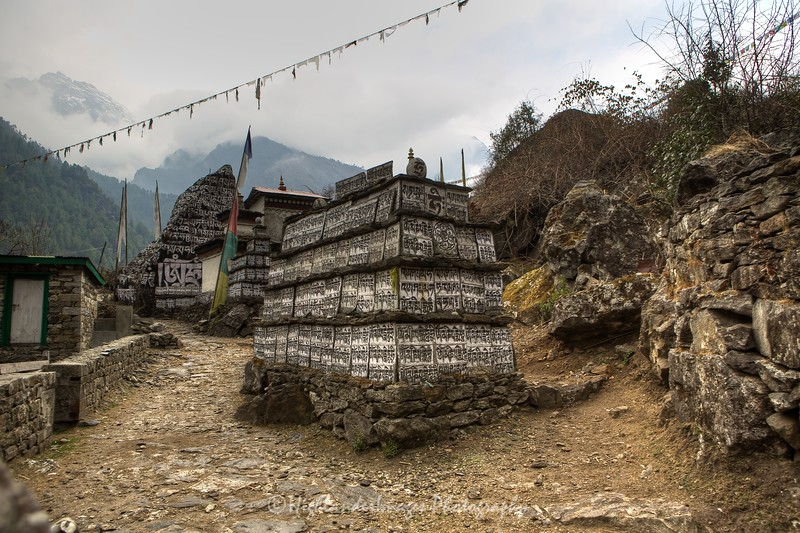 Mani stones between Koshigaun village and Phakding